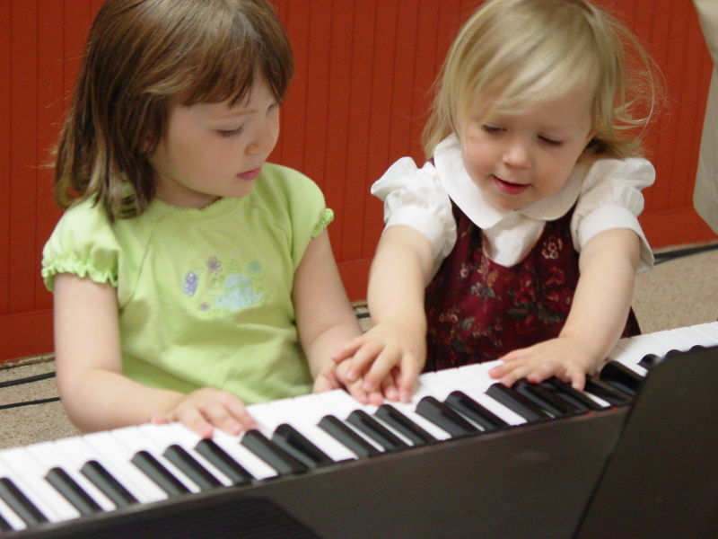 Girls of Immanuel OPC playing piano